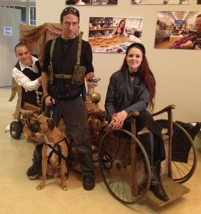 Hans, Micho, Kristine, and Belvedere next to the Puppy Powered, Steampunk Chariot!