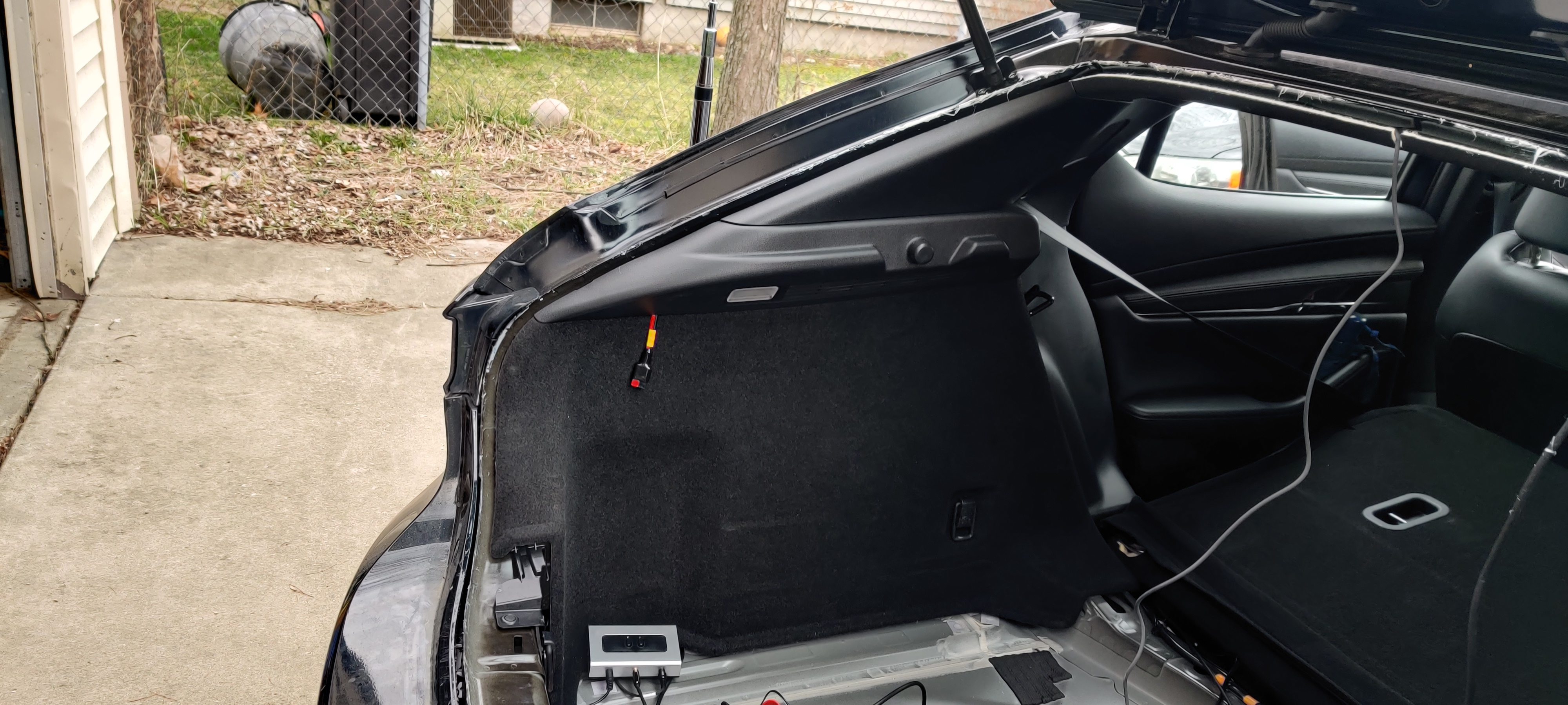 Driver's side rear quarterpanel, now with radio and subpanel installed. Note the 20A PowerPole drop tucked under the cargo area LED, and the 1-2 switch for external speaker (soon to be replaced with an actual mixer). Not shown (because framing!) programming cable extension.