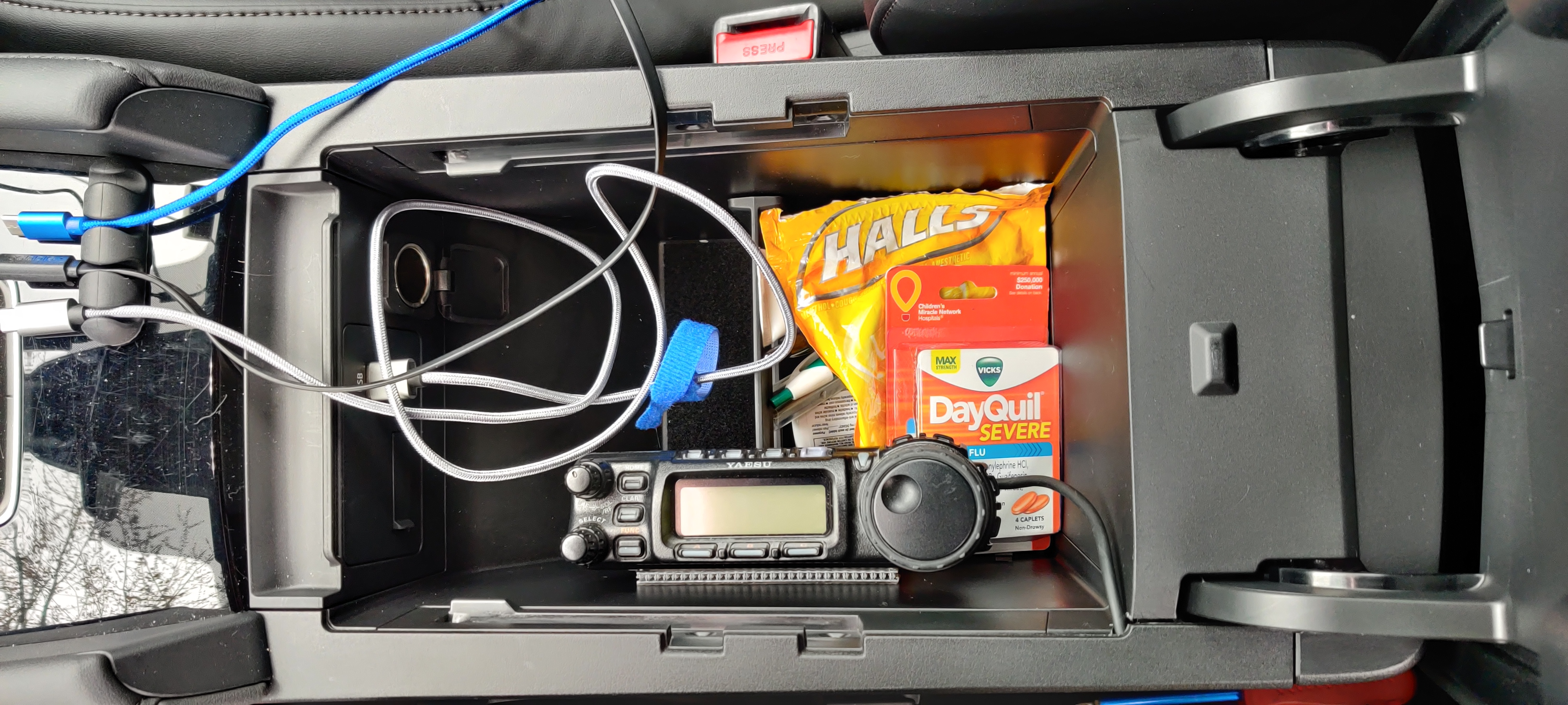 FT-857D head mounting inside center console storage bin. Note the one and only accessory port in the car, and the cable neatly going under the trim panel...