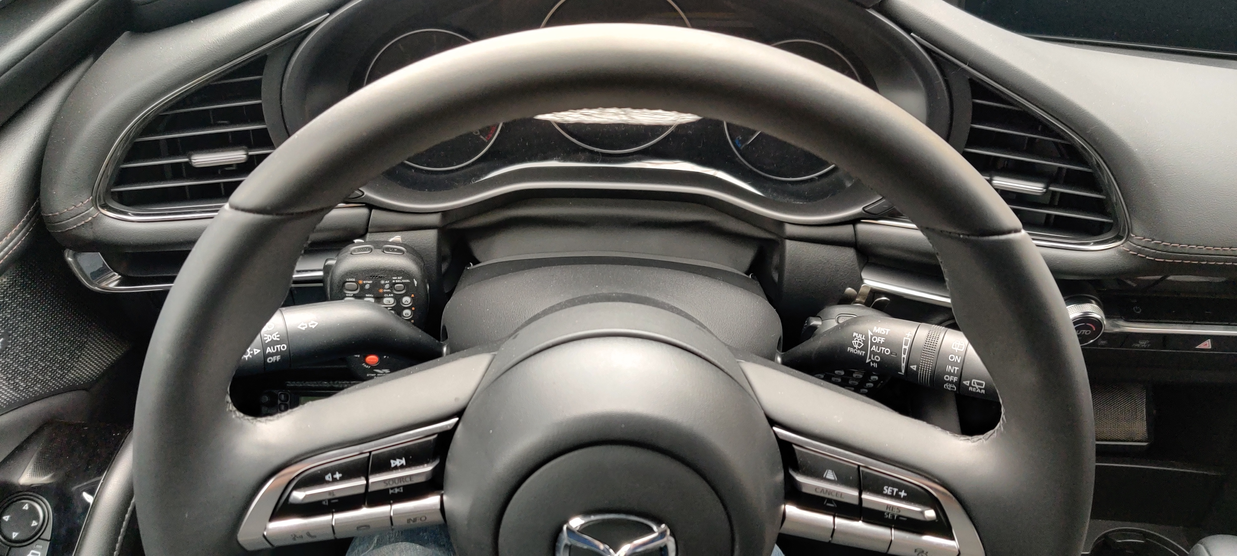 Overhead shot showing both mics nestled around the steering column.