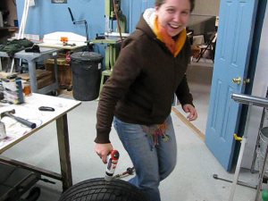 Sharon drills a hole in our practice tire